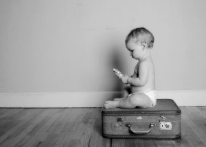 bigstockphoto_Baby_On_Suitcase_414811